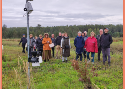 Participants of Field day near ATLAS meteorological station in blueberries plantation listening about data transfer, importance and possible use of environment data.
